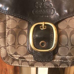 Shoulder purse , leather and signature Coach